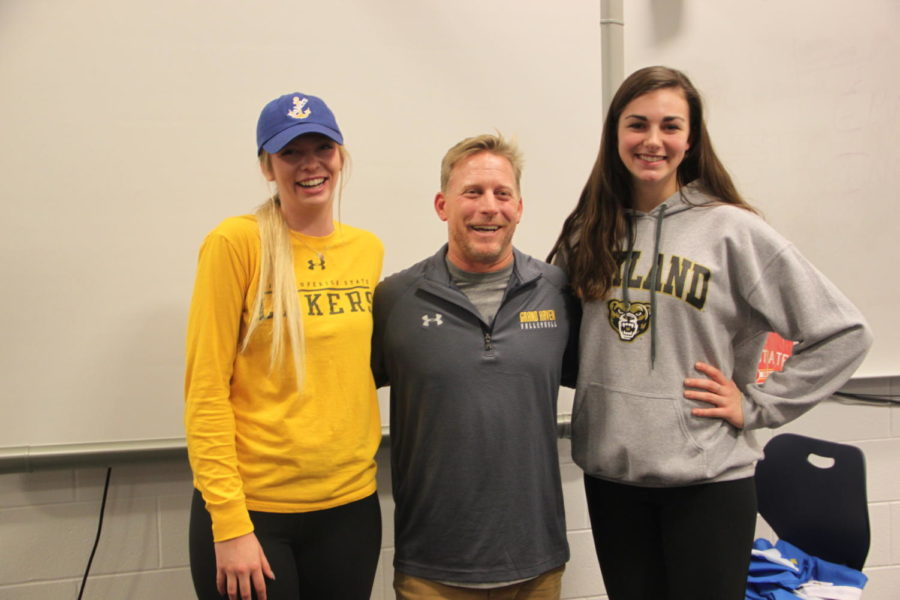 Seniors+Avery+Strohmeyer+and+Avolyn+Lepo+pose+with+their+coach+Aaron+Smaka+on+signing+day.+Strohmeyer+is+headed+to+Lake+Superior+State+University%2C+while+Lepo+signed+for+Oakland+University.