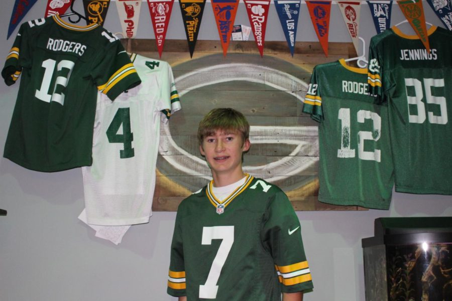 Hosley poses in his bedroom with his collection of Green Bay Packers jerseys. From left to right: Aaron Rodgers (#12), Brett Favre (#4), Aaron Rodgers, Greg Jennings (#85). Hosley is an avid fan of the team and follows them intently, which is why his first jersey was an Aaron Rodgers one.