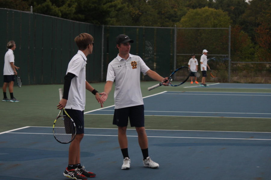 Senior+Mason+Price+celebrates+a+point+with+his+partner.+Price+had+a+good+year+playing+No.+2+singles+for+the+Bucs.