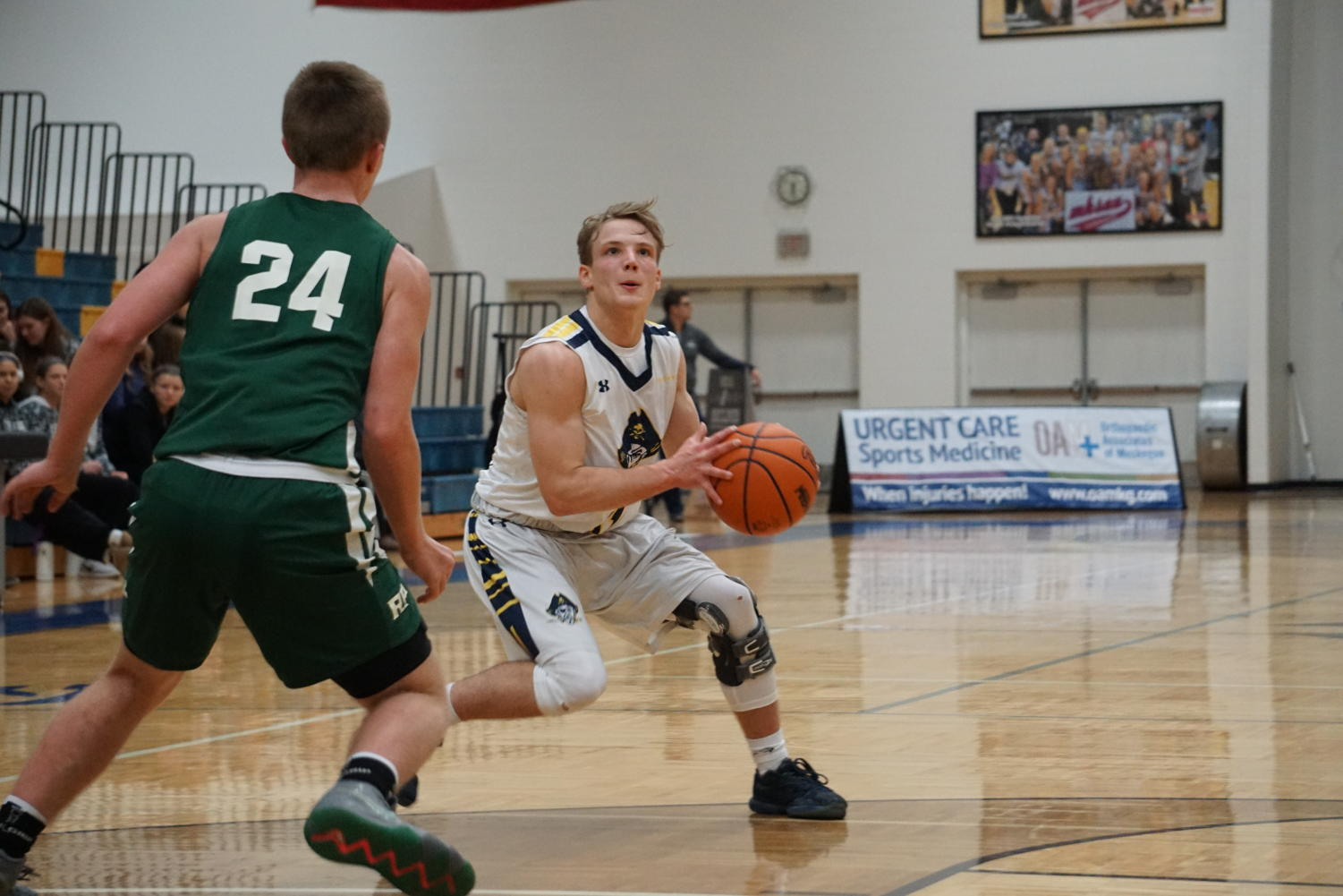 Senior point guard Casey Constant works to create space in order to find an open look for a shot against Rocket defender.