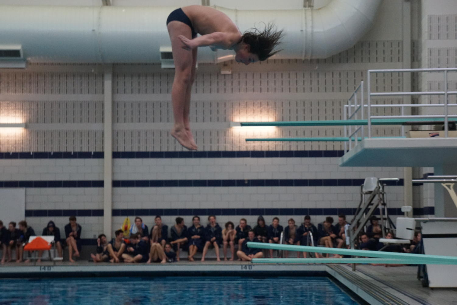 TAKING A DIVE: Malott executes a challenging dive during a meet. The junior brightens the squad's spirits with his energy that is often contagious for everyone around him. This also is noticeable in the style of Malott's leadership and personality.