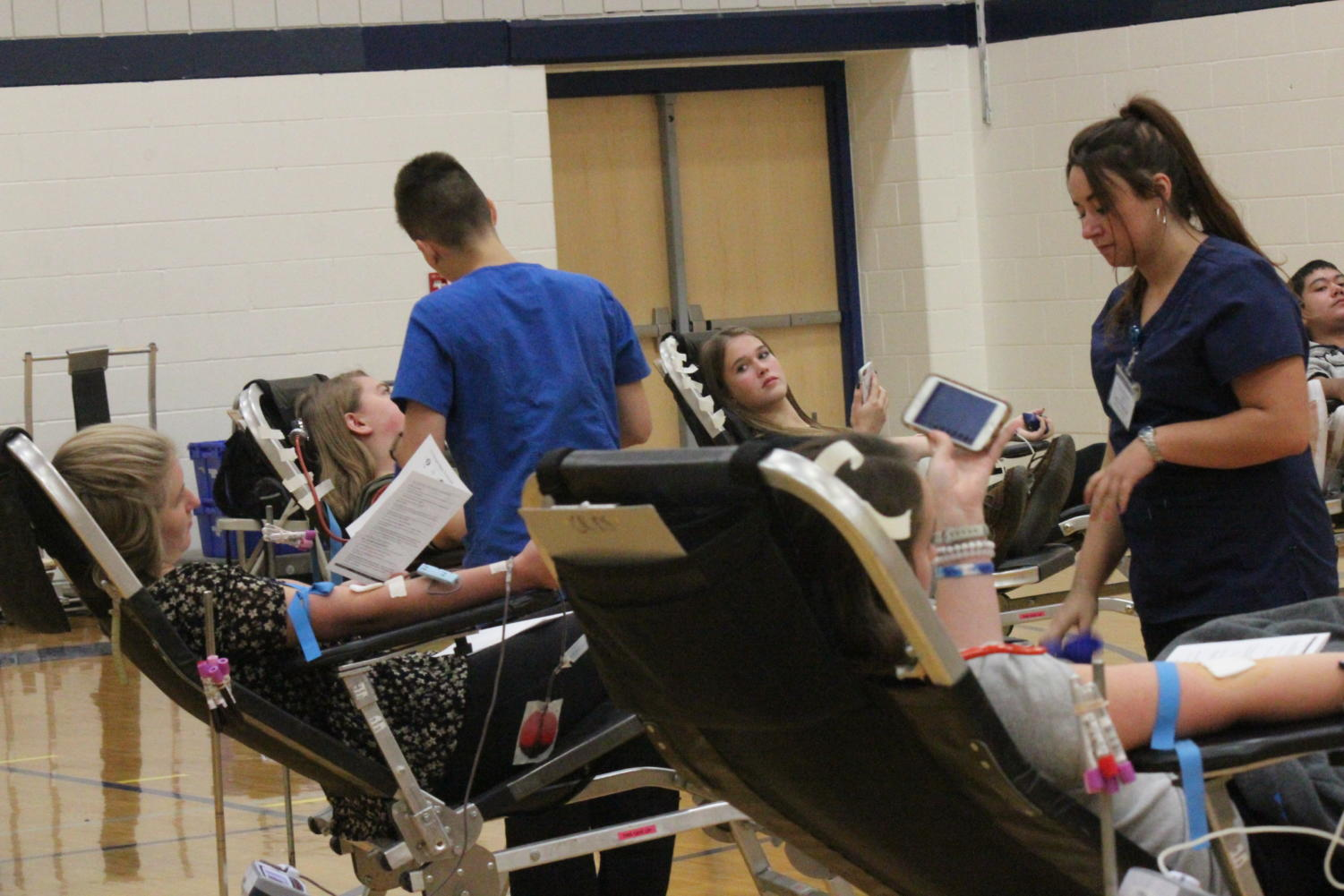 Students of science teacher Todd Diederichsen help out at recent blood drive in order to meet local quotas for blood.