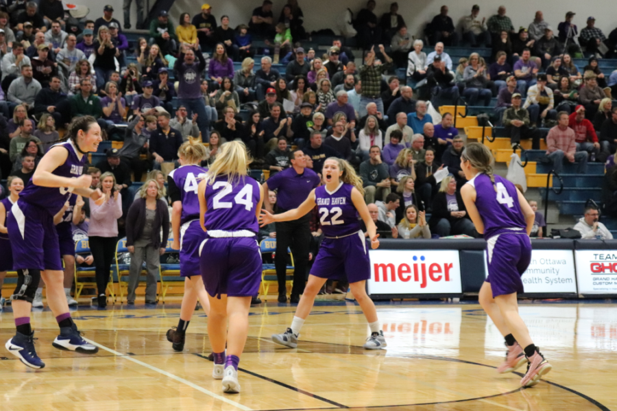 Junior+Jolee+Houle+celebrates+with+her+team+after+a+high-scoring+first+half+against+East+Kentwood.+Houle%2C+the+team%27s+primary+outside+shooter%2C+had+18+points+in+a+loss+to+Muskegon+in+the+district+opener.