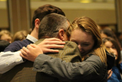 Co-Editors-in-Chief Chris Hudson and Maddie Monroe hug advisor C.E. Sikkenga after winning the Spartan Award.