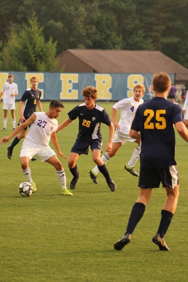 Boys soccer starts slow, never recovers in loss to Hudsonville