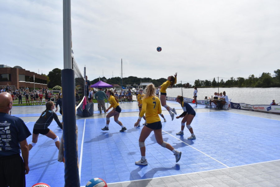 Senior Ashley Slater serves the ball over the net to the opposing team. The Grand Haven girls volleyball team won Battle on the Boardwalk  on Saturday September 7.