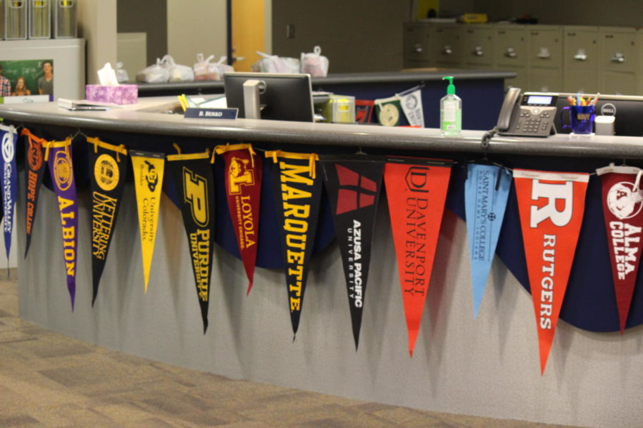 The banners hanging in student services represent a variety of colleges in Michigan and out of state as well.