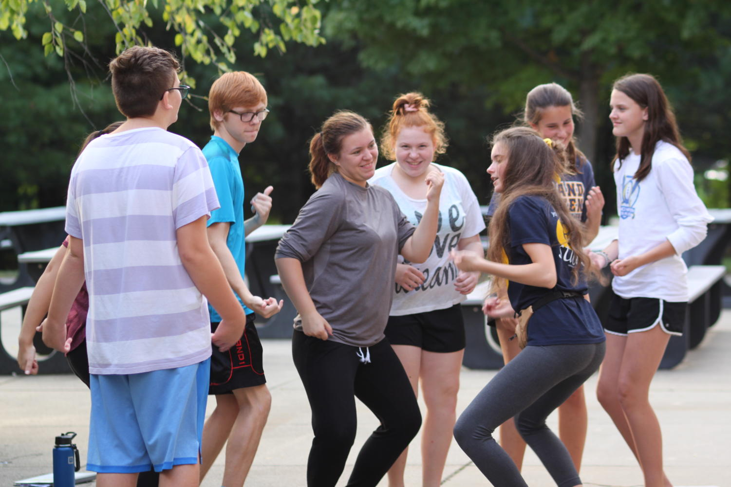 Choir students learn dance moves to  one of the many choir dances. To learn the dance they split up into small groups where they met new people and learned new moves.