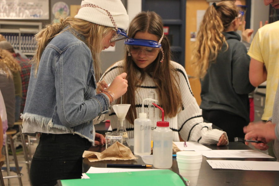 Senior Megan DeKuiper and Senior Kammi Jarvis work on a lab for their AP chemistry class. Chelsea Bender held a night lab at school for her AP Chemistry students on Wednesday October 2.