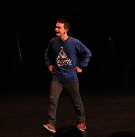 Senior Cal Coyne grins as he walks up on stage while the audience sings to him on his 18th birthday.