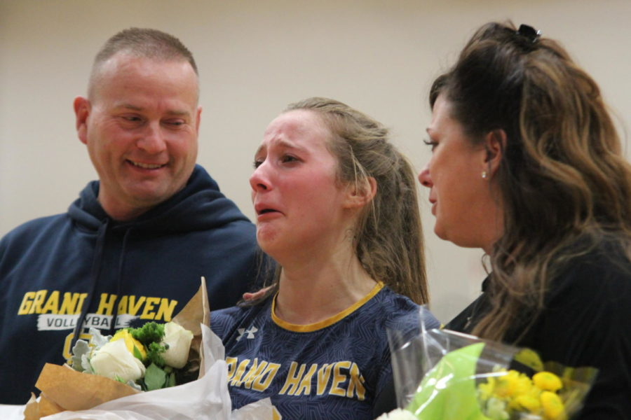 """Senior Reilly Swierbut walks across the court with her parents for the last time. """"In this moment, I saw both of my sisters crying,"""