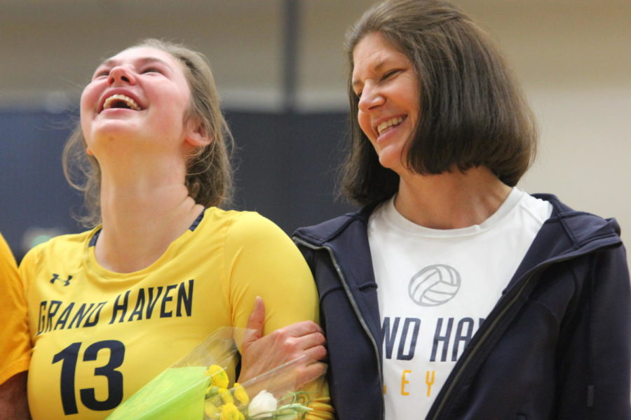 Senior Sarah Knoll laughs with her mom as she reminisces over past seasons.