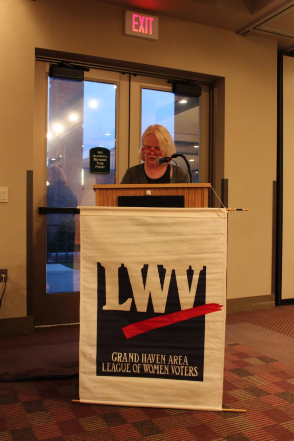 President Christine Baker of the Grand Haven League of Women's Voters chapter presides over a debate involving the two Grand Haven city mayoral candidates.