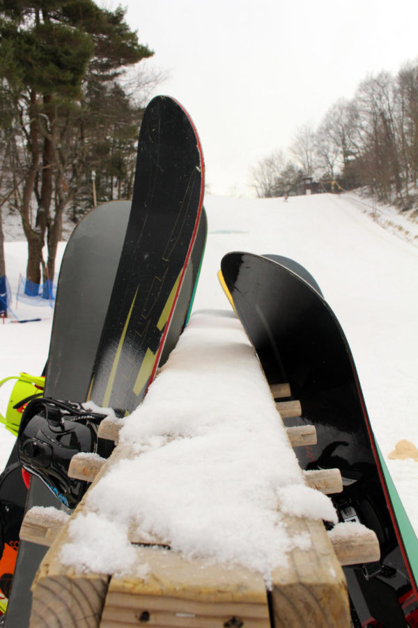 Skis lean on a ski rack at Mulligan's Hollow. The ski team hopes for success in the upcoming season as winter sports approach.