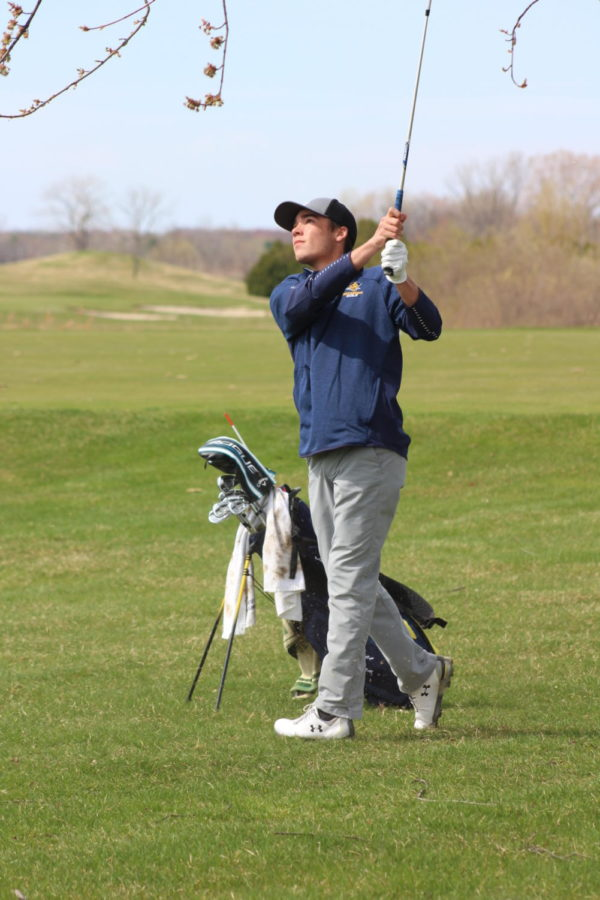 Senior Broc Wilson keeps an eye on his ball after his swing at a match in the 2019 season.