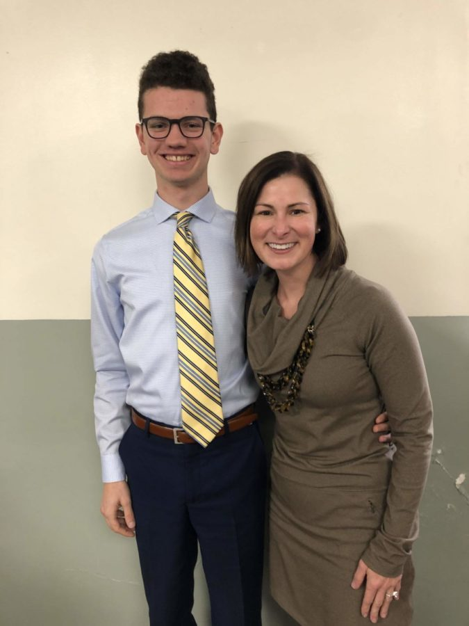 Senior Caleb Berko was honored as a November student of the month alongside principal Kate Drake.