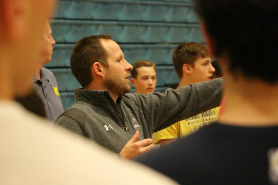 Greg Immink instructs players during a drill at a pre-season practice before tryouts.