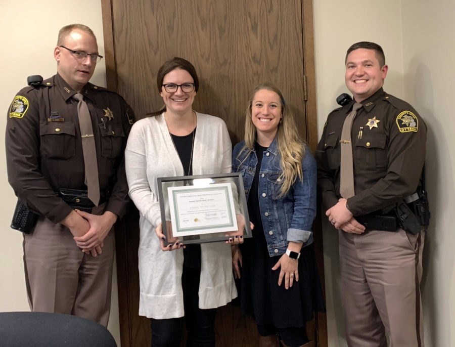 Deputy Mackeller and Mrs. Schmitt along with others received the