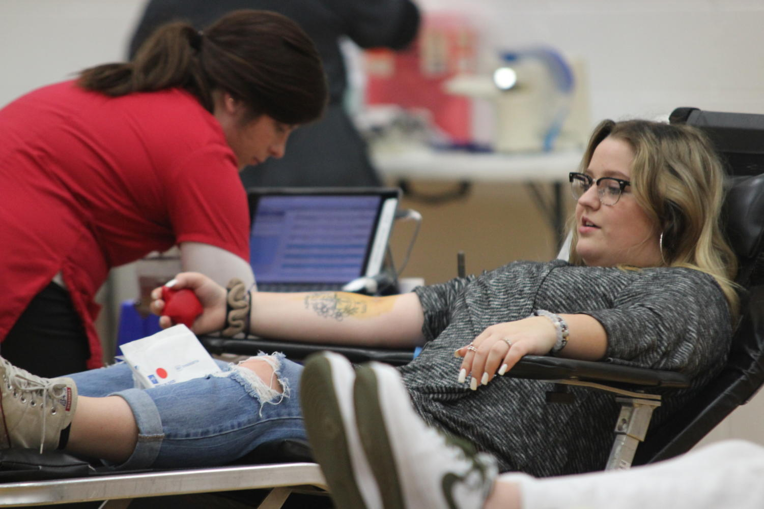 Senior Sydney Johnson prepares to give blood. Johnson was one of 63 individuals to donate blood for the event.