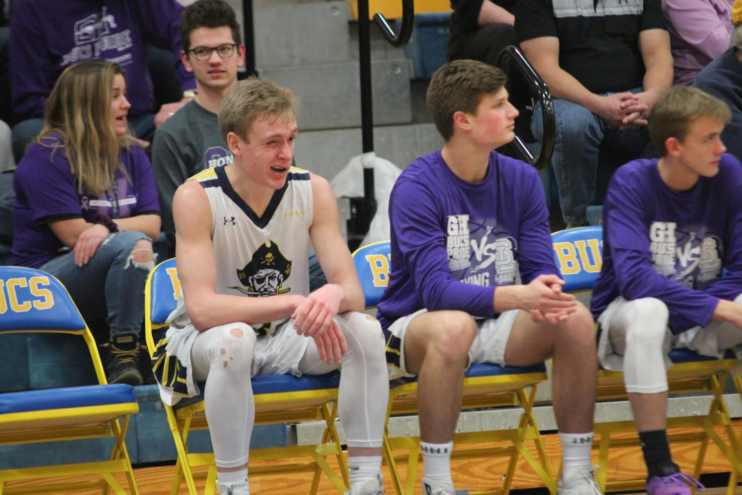 Senior Andrew Sinke shakes off his eye injury in a game against Spring Lake. Sinke is the team's sharpshooter.