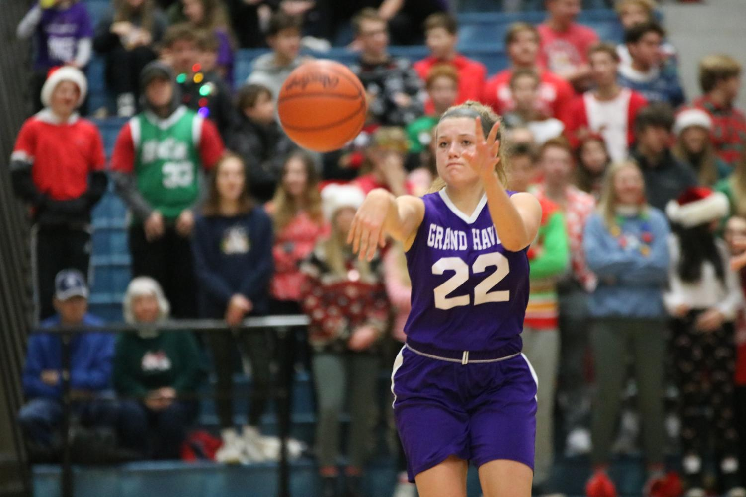 Houle passes the ball in the Bucs Pride game against Spring Lake on Friday Dec. 20.