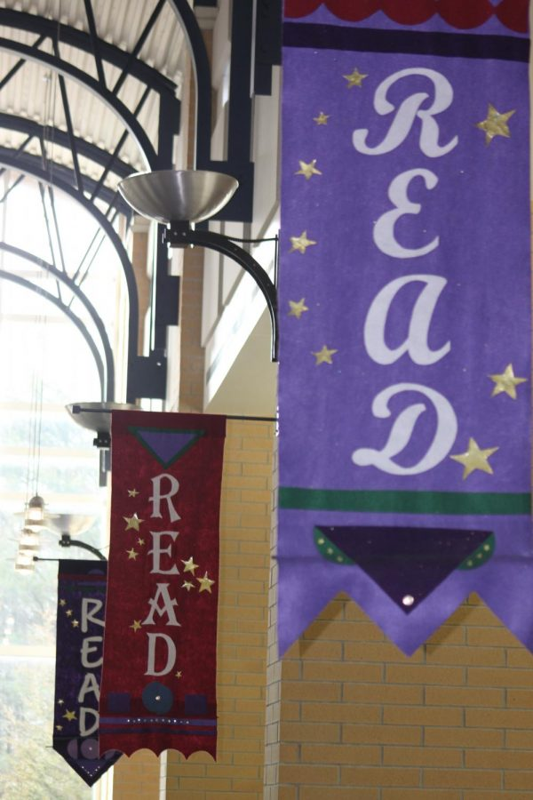 Banners+in+the+library+set+the+mood+for+reading.+A+steady+flow+of+students+make+their+way+through+the+library+daily.+