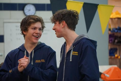 Seniors Adam Wassell and Alec Slaggert turn to each other smiling and laughing as their diving coach, Scott Klempel, talks about them, all the impacts they have made and all the memories they have created throughout the last four years.