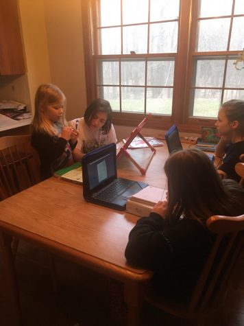 Senior Emma Chittenden teaches her two younger sisters and cousin amid school shutdown.