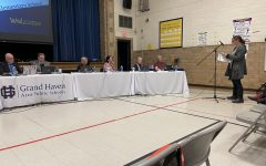 Community member Jennifer Stuppy presents to the GHAPS school board on Monday, March 9. She was there requesting the board create a new policy that would require parents to sign a consent form allowing their children to have access to sexually explicit content in district libraries.