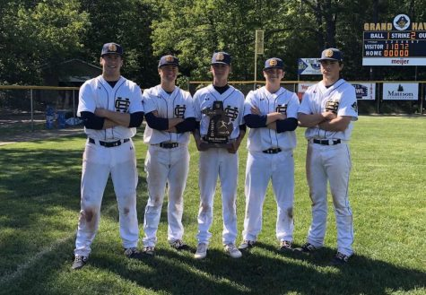 From left to right: now seniors Connor Worthington, Alex Kapala, Tyler Harp, Caleb King and Owen Krizan pose with the District Champions trophy they won in 2019.