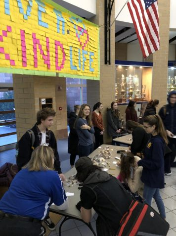 On National Leap of Kindness Day, DoRAK spread kindness to all by giving away Oreos donated by Sweet Temptations. Vice President Maddy Streng watches as students fill out cards to give with their Oreos to their friends.