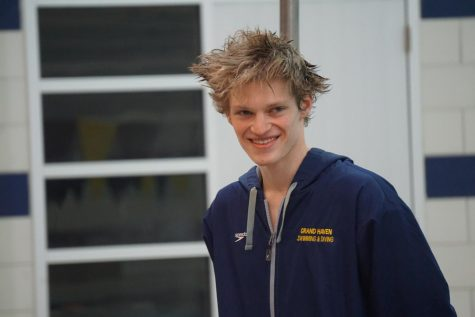 Senior Jack Timmer canot help but beam as the boys swim senior night ends; he is thankful for this season.