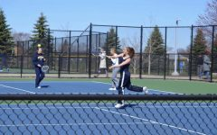 Senior Samantha Korecki serves the ball while preparing for her match.