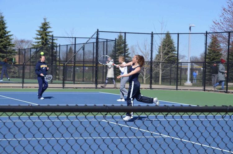 Senior Samantha Korecki serves the ball while preparing for her match.