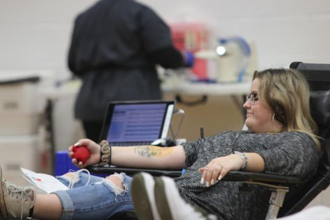 BLOOD FLOW: A student participating in a blood drive last year squeezes a stress ball to help the blood in her arm flow easier into the tube.