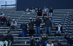 Spectators watch on during the Grand Haven v East Kentwood game.