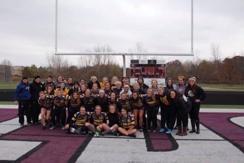 WINNING: The girls rugby team pictured after their third place win in fall 2019.