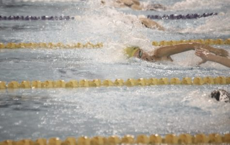 Senior Ocean Veldhouse battles the 100 freestyle in last year