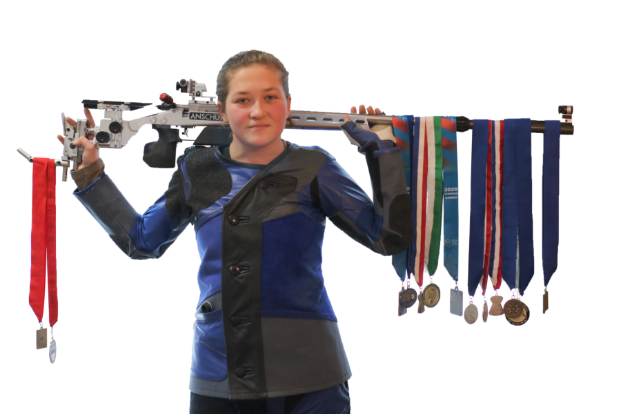 MEDALS%3A+Adrianna+supports+one+of+her+rifles+on+her+shoulders+while+showing+off+many+of+her+medals.+Over+the+course+of+her+career+she+has+collected+even+more+than+what+is+shown+but+they+couldn%27t+all+fit+on+the+gun.+