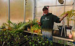 GREENHOUSE GOD: Glass shows different types of plants that students are growing in his Greenhouse Biology class whether it may be different types of vegetables or houseplants.