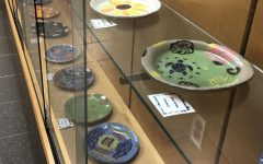ON DISPLAY: Student's ceramic artwork is displayed in the showcases in the first floor main hallway.