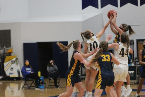 A FOOT ABOVE: Keefe gets her hands on the basketball as Hudsonville point guard goes up for the shot. Even at 5
