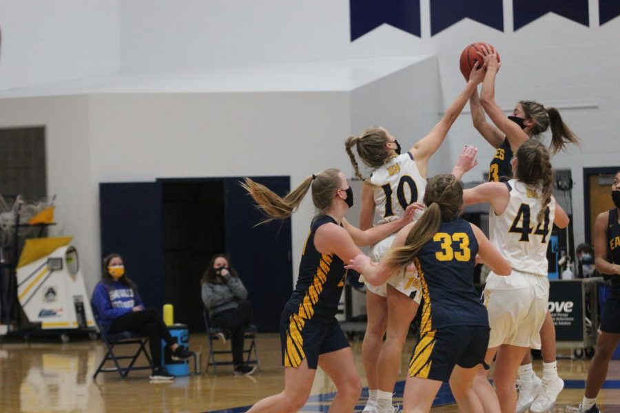 A FOOT ABOVE: Keefe gets her hands on the basketball as Hudsonville point guard goes up for the shot. Even at 5'8
