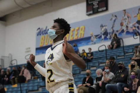 Boys varsity basketball pulls away with win against Hudsonville
