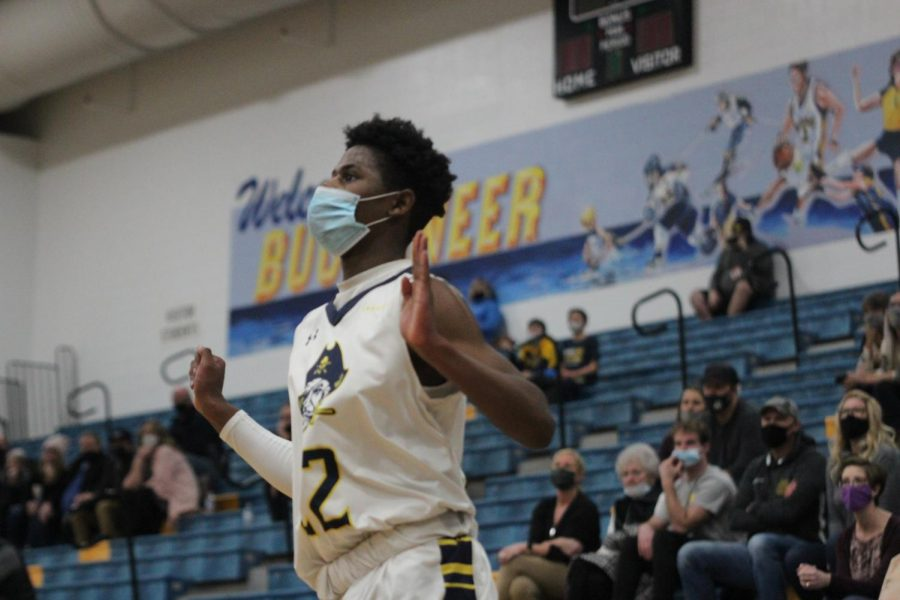 Boys varsity basketball pulls away with win against Hudsonville