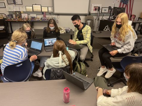 HARD AT WORK: Future PREPd members collaborate to finish the slideshow for an upcoming presentation. I think it is important to be in this club because it gave me a lot of chances to work on a group project that isnt school, Ritter said. Learning how to work well with others is important.