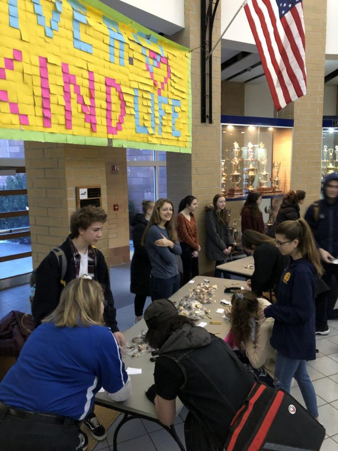 Students participating in a DoRAK event by sending kindness to their friends.