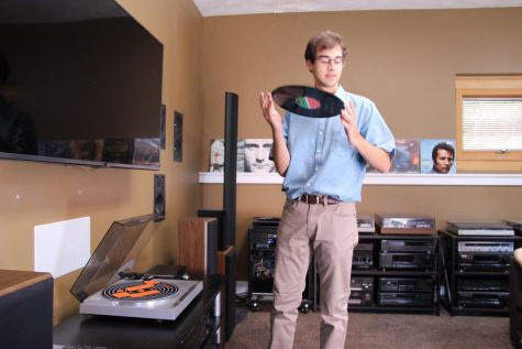 Senior Mike Baldus picks up a record to clean it off. Baldus started vinyl club with the intention to listen to more music on this medium.