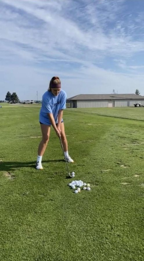 Senior Zoe Spoelman practicing for her match at the range.