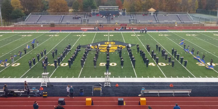 The marching band preforms at the last home game of the 2020 season. The band recently hosted the Grand Haven Marching Band Invitational and competed against eight other schools.